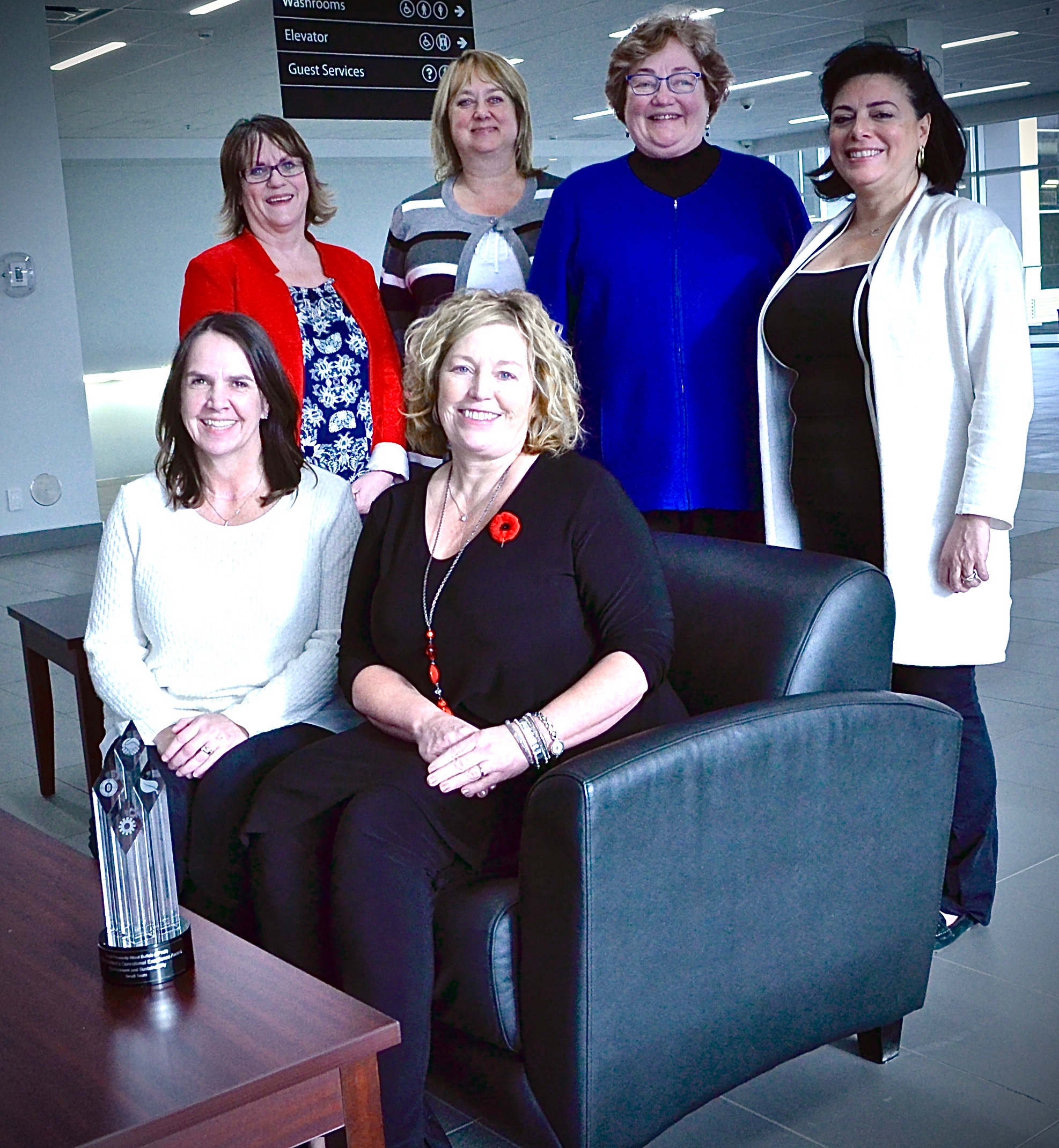 Suncor Energy last week honoured Fort McMurray's Social Prosperity Wood Buffalo Initiative with a President's Operational Excellence Award. The SPWB steering committee includes (seated, from left) Kim Nordbye and Diane Shannon; (standing, from left) Bonnah Carey, Tracey Carnochan, Cathy Brothers and Sana Elache.